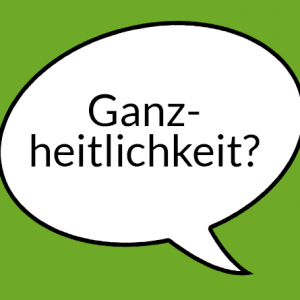 """Weiße Sprechblase auf hellgrünem Grund mit Aufschrift """"Ganzheitlichkeit"""""""