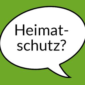 """Weiße Sprechblase auf grünem Grund mit der Aufschrift """"Heimatschutz?"""""""